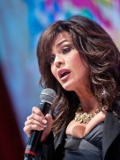 Marie Osmond - Dress can barely contain those huge breasts!